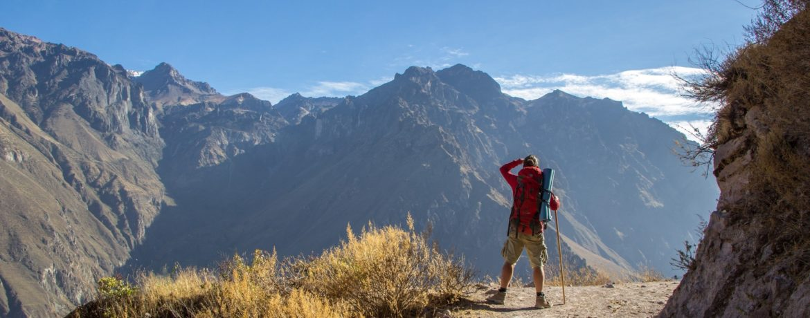 Tourists looking at the mountains in the canyon Cotahuasi, in the province of Arequipa, Peru.